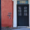 """Katrina X"" Rescuers painted symbols on the outsides of buildings to indicate when it had been searched and by whom.  This home located in the Marigny/Bywater district, duplicated the inspection symbol in metal as a permanent reminder."