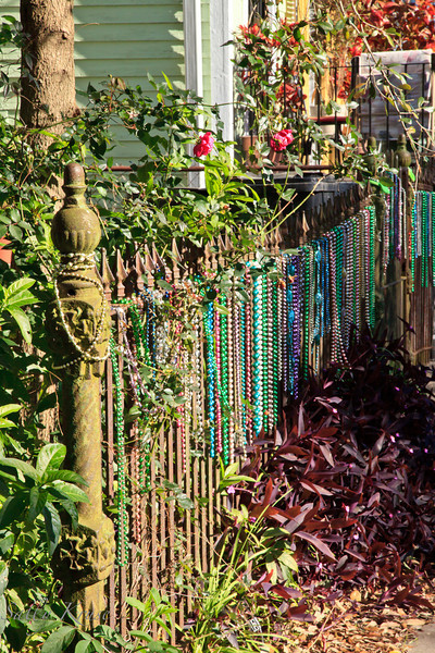 Beads decorating the wrought iron fence outside a home in the Marigny/Bywater district, New Orleans.