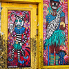 Colorfully painted then damaged entry to a club in the Marigny/Bywater district, New Orleans.