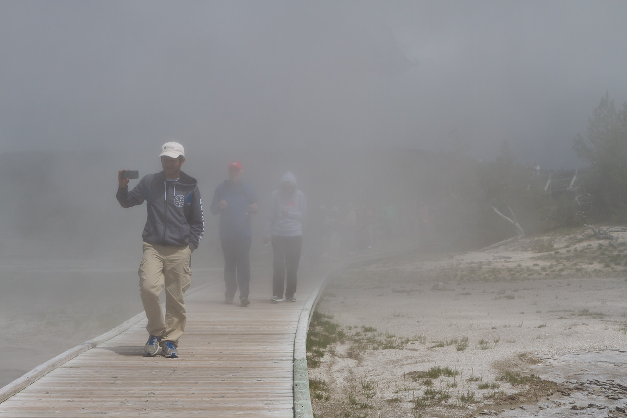 Visitors in Mist at Fountain Geyser at Yellowstone National Park