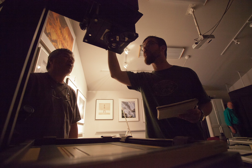 Mike and Wilton check settings before developing film in the darkroom.
