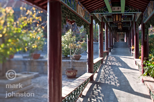 Long covered walkways connect the various buildings of the Mu Clan Mansion, within the town of Lijiang, Yunnan Province, China.  The mansion belonged to a local chief during the Ming Dynasty.