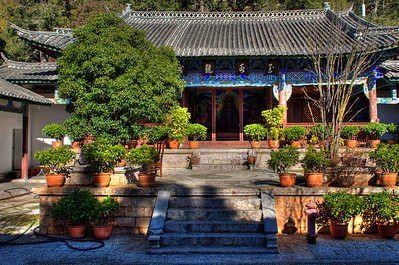 A garden and building in the temple complex in Jade Spring Park, north of the city of Lijiang, Yunnan Province, China.