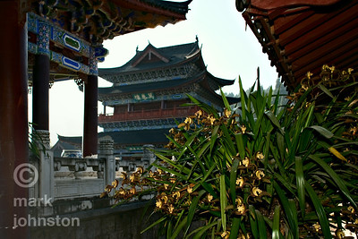 Flowers bloom among the shaded pavilions of the Mu Clan Mansion in the town of Lijiang, Yunnan Province, China.  This complex housed the family and retainers of an ethnic chief of the Ming Dynasty.