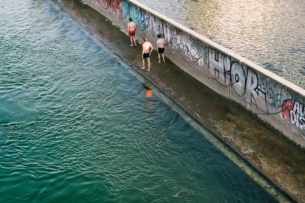 People enjoying summer in Zurich at the Limmat river