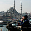 Sunday morning fishing at Galata Bridge. Yeni Mosque in the background.