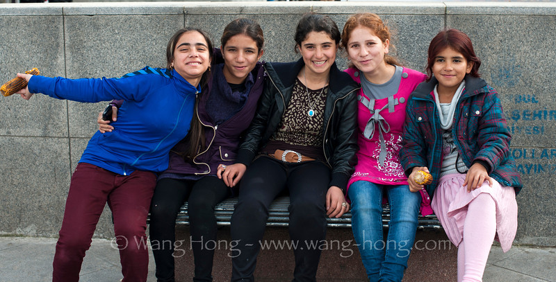 Cheerful girls enjoying corns near Yeni Mosque and getting excited posing in front of my camera.