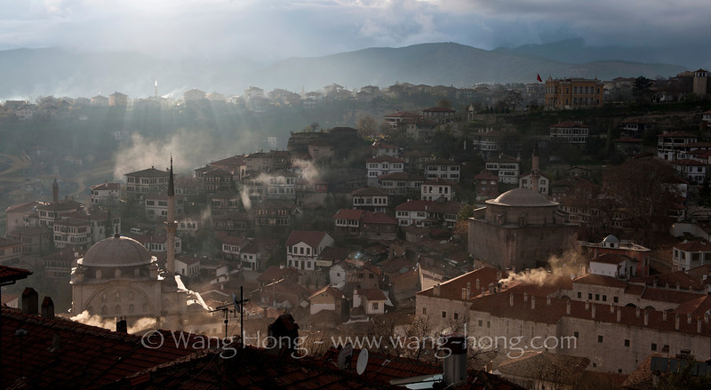 Safranbolu in late afternoon sun piercing through clouds. The well-preserved Ottoman town, 200 kilometres north of Ankara and about a 100 km south of the Black Sea coast, is a UNESCO World Heritage.