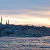 Istanbul from Bosphorus water front at sunset in late March, with Süleymaniye Camii in the view.