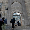 Women going up to the Yeni Camii Sunday morning.