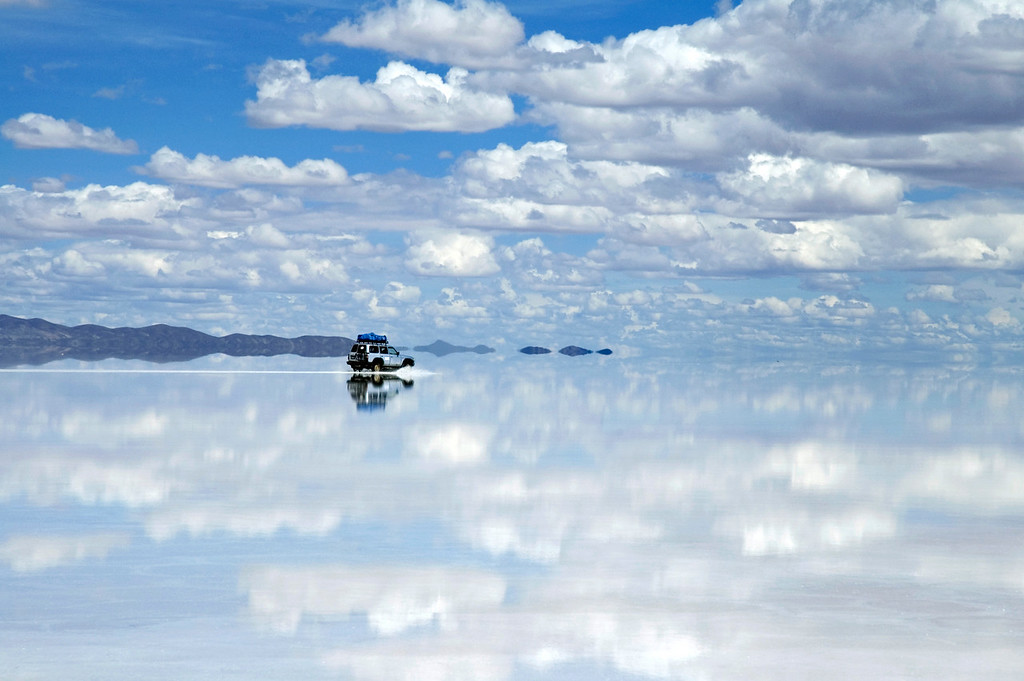 Uyuni, Bolivia The Bolivian salt flats are a 4,085 square mile (10582 square km) bright white expanse. In the summer though it rains enough that they are covered in water, sometimes more than a meter. It makes for an incredible reflection.
