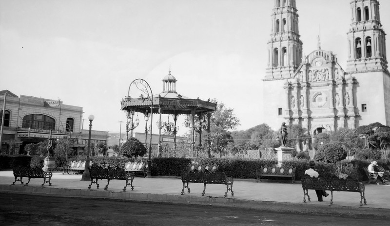 A shot in the 1920s of the Cathedral of Chihuahua. More info on it here: http://en.wikipedia.org/wiki/Cathedral_of_Chihuahua. The gazebos are still there!