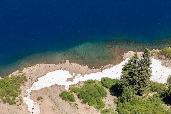 Snow on the beach at Crater Lake