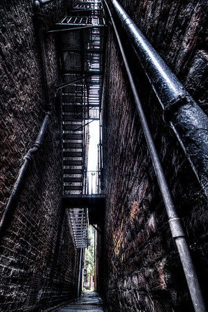 Only a few feet wide spectral fire escapes loom over the brick-sided alley of Plummer Chare in Newcastle