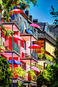 Colourful umbrellas keep the sun off neat balconies at Zell, by the River Mosel in Germany