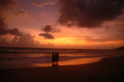 Goa, India A family enjoying an incredible sunset at Calangute beach.