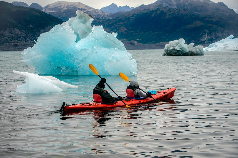 Kayaking around icebergs