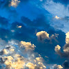 Backlit clouds in a blue sky