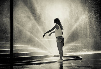 Girl cools down in Warsaw fountain as temperatures soar