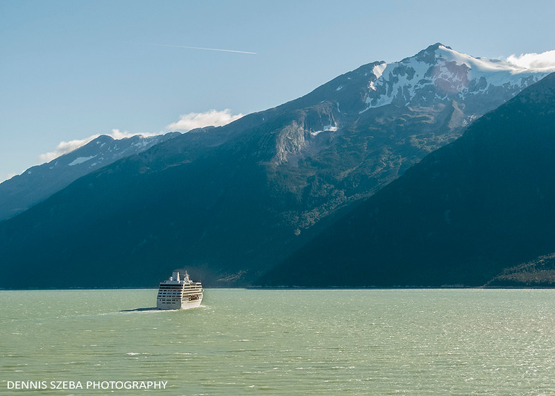 Cruise ship dwarfed by Alaska Mountains. 2018