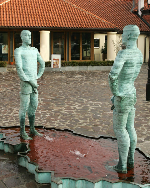 Pissers, animated sculpture in courtyard of the Franz Kafka museum, Prague.