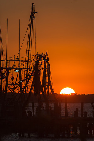 Shrimp boat at sunset