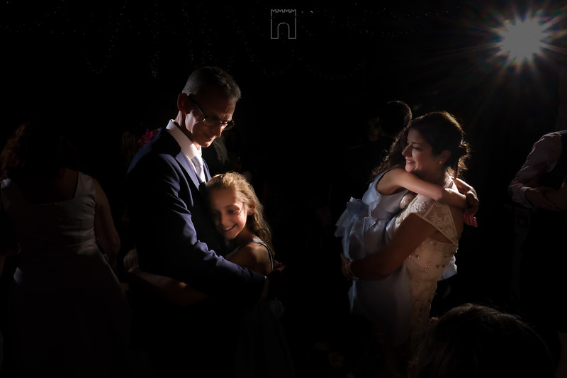 family embrace at wedding