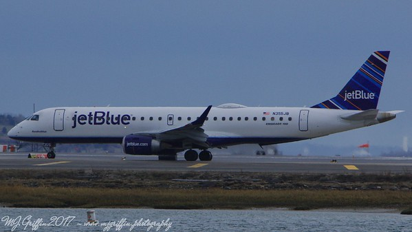"Jet Blue's ""Rendezblue"" Embraer 190 waiting to take off at Boston's Logan Airport."