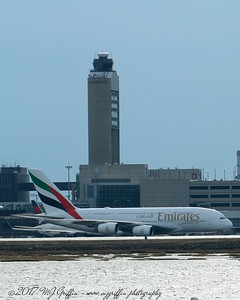 Emirates Airbus A-380 passing the tower at Boston's Logan Airport.
