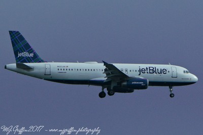"JetBlue ""Born to be Blue"" A320 landing at Logan Airport."