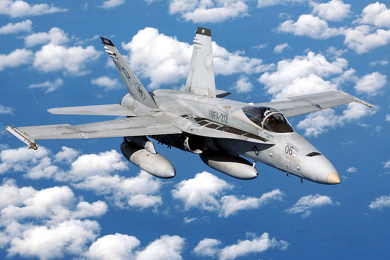 This is a photo of an F/A-18 Hornet. The F/A-18D Hornet was similar on the outside but carried 2 crew members instead of 1. In addition these Hornets carried the Advanced Medium Range Air-to-Air Missile (AMRAAM) and the infrared imaging Maverick air-to-ground missile. The C/D models came with improved night attack capabilities. The new components included a navigation forward looking infrared (NAVFLIR) pod, a raster head-up display, night vision goggles, special cockpit lighting compatible with the night vision devices, a digital color moving map and an independent multipurpose color display.