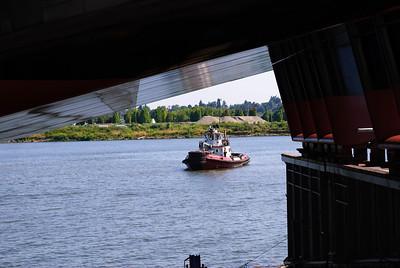 7.07.12  Barge Launch!  A tug awaits the brand new 250' barge ready to be dropped into the water.  Portland, Oregon