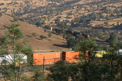 In this picture, the train has made the turn around the hill and is heading toward the tunnel that will take the front of the train under the middle portion of the same train.