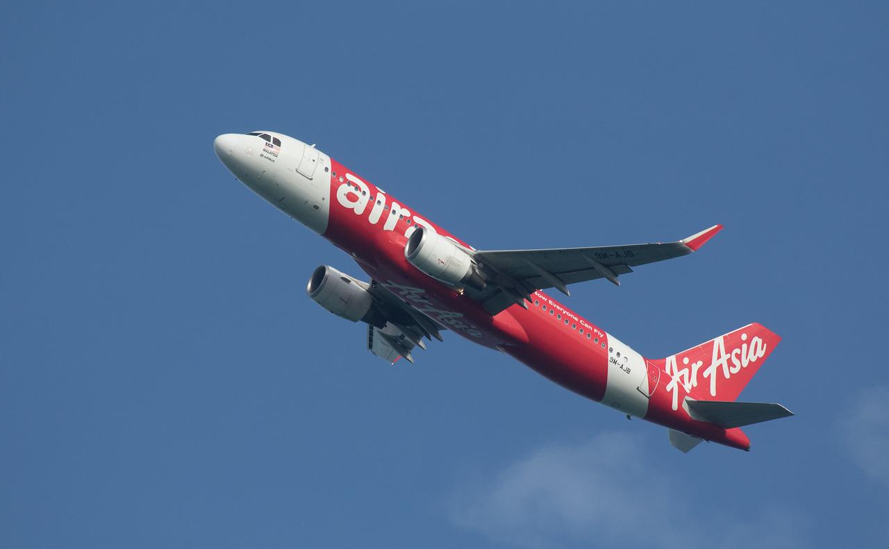 Air Asia A320-216 9M-AJB as AK6309 taking off from Langkawi LGK WMKL.
