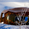 Old car frozen in time after the 1964 Alaska earthquake sunk the land ~ near Girdwood, Alaska.
