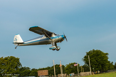 A restored 1948 Luscombe, Model 8F on landing approach at Will Rogers Memorial Fly-in near Oologah, Oklahoma.