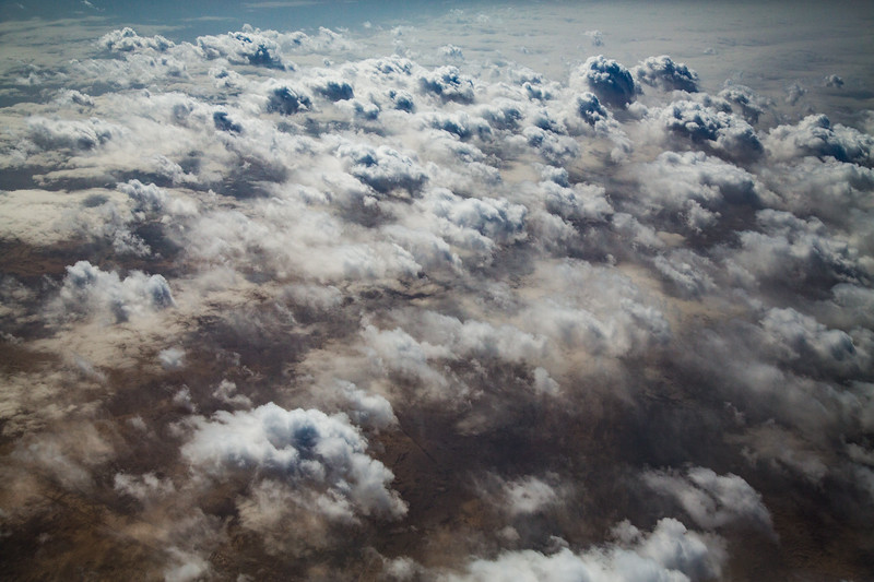 Somewhere over Tajikistan, the smudged white clouds drifted above the parched brown land to create a fleeting meteorological work of art. #EarthOnLocation #BBCEarth #Cloudscape #Weather #Desert #Tajikistan #Plane #Aerial #Cloud