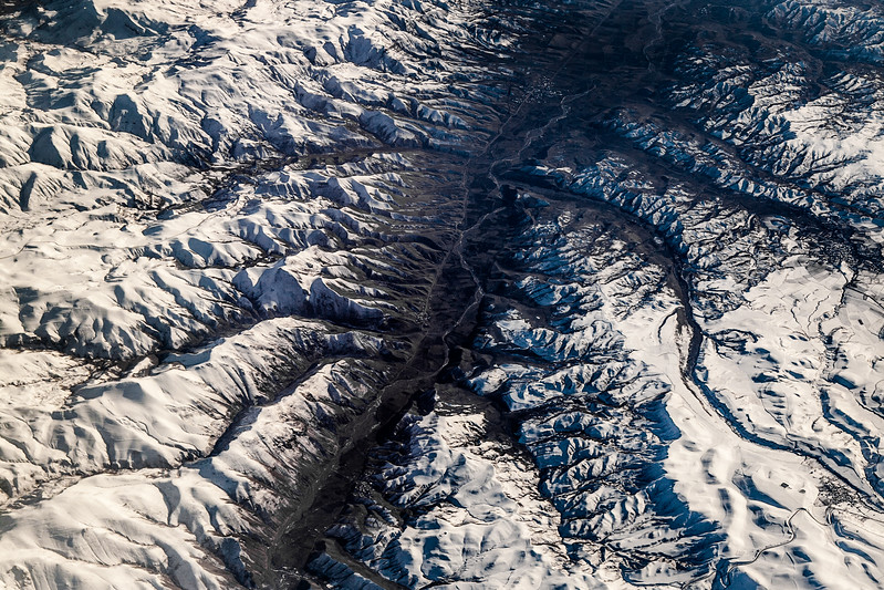 View from plane of Elburz Mountains, snow covered, South Iran (Post work to increase contrast and clarity to compensate for atmospheric haze).