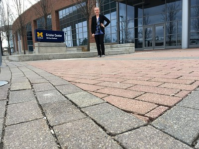 Ecokelly checks out the porous pavers at the Crisler Center