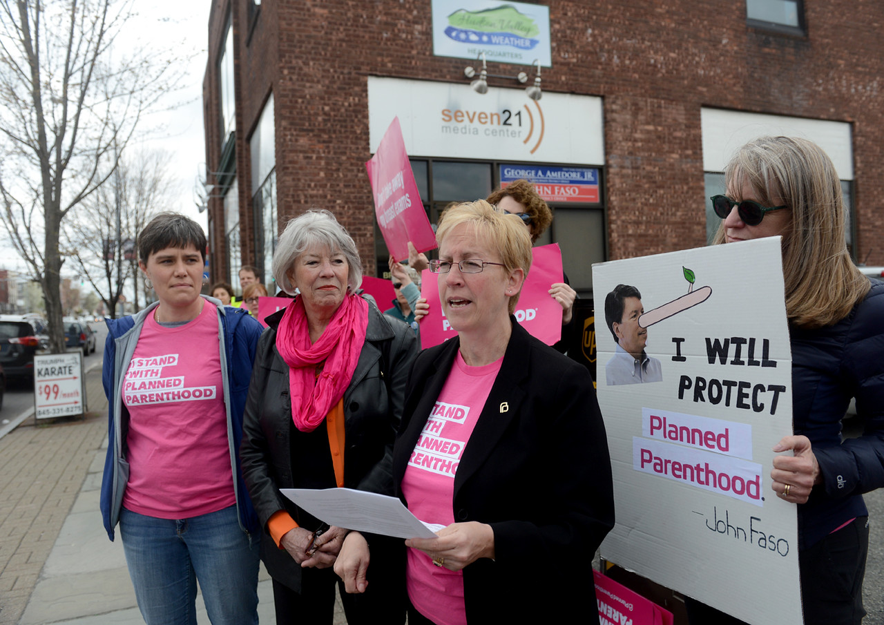 Tania Barricklo-Daily Freeman                      Fran Fox- Pizzonia, the Vice President of Education and Public Affairs of Planned Parenthood Mid Hudson Valley, speaks at a press conference Wednesday outside of Congressman John Faso's office in Midtown Kingston, N.Y. The group, which included CEO Ruth-Ellen Blodgett, second from left, and patient Jess Robie of Rosendale, left, and othersupporters addressed their concerns of Faso's support of cutting out federal funding for Planned Parenthood.