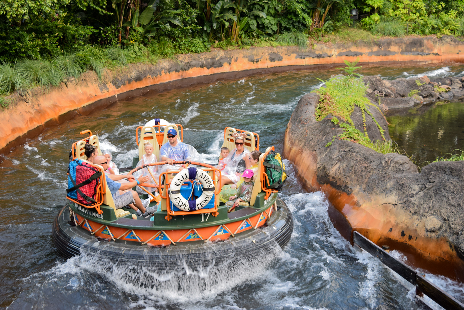 How to Plan Your Trip: Having fun at Walt Disney World Magic Kingdom on a water ride.