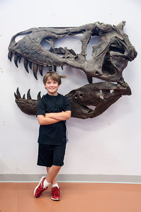 We went to Grand Rapids and visited the Children's Museum.  They have a T-Rex skull mounted on the wall and I took a photo of Connor next to it.