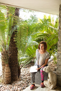Shireen on the front entrance walkway with Cycas species