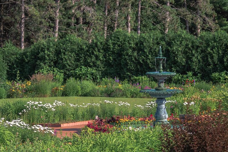 Promenade Fountain with daisies