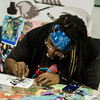 Frankie B. Washington works on some art during the Plastic City Comic Con held at the Wallace Civic Center in Fitchburg on Saturday, July 29, 2017. SENTINEL & ENTERPRISE / Ashley Green