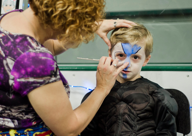 Dante Richard, 5, of Leominster, gets his face painted by Sheri Sharkey of Chamillion Colors, during the Plastic City Comic Con held at the Wallace Civic Center in Fitchburg on Saturday, July 29, 2017. SENTINEL & ENTERPRISE / Ashley Green