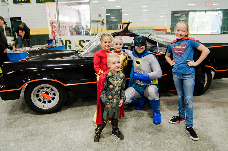JJ Blanchard, 4, Chloe Peterson, 8, Jacob Blanchard, 7, and Jordan Blanchard, 10, pose with Batman Michael Conlon during the Plastic City Comic Con held at the Wallace Civic Center in Fitchburg on Saturday, July 29, 2017. SENTINEL & ENTERPRISE / Ashley Green