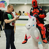 Richard Ortwein, from That's Entertainment, speaks with Paul Hogan, dressed as Deadpool riding Buttercup, during the Plastic City Comic Con held at the Wallace Civic Center in Fitchburg on Saturday, July 29, 2017. SENTINEL & ENTERPRISE / Ashley Green
