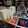Frank Malec, of Connecticut, signs copies of his prints during the Plastic City Comic Con held at the Wallace Civic Center in Fitchburg on Saturday, July 29, 2017. SENTINEL & ENTERPRISE / Ashley Green