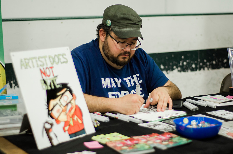 Chris Gugliotti works on some art during the Plastic City Comic Con held at the Wallace Civic Center in Fitchburg on Saturday, July 29, 2017. SENTINEL & ENTERPRISE / Ashley Green